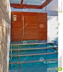 house entrance with stairs over a small pool stock photo image