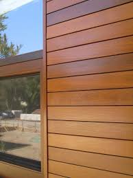 wood paneling exterior vinyl siding that looks like wood climate shield rain screen