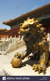 gold lion statue a gold lion statue in the palace of peace and longevity at zijin
