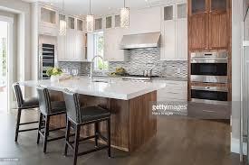 White Pendant Lights Kitchen by Pendant Lights Over Modern White Kitchen Island Stock Photo