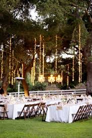 decoration with hanging lights from trees wedding with white