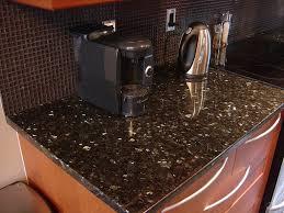 granite countertops with glass backsplash in kitchen my home