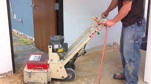 Sandpaper For Concrete Floor by Removing Carpet Glue From Concrete Floor Youtube