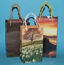 make your own gift bags out of wrapping paper old calendars