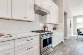 white shaker kitchen cabinets with gray quartz countertops shaker style cabinets kitchen bath countertops granite