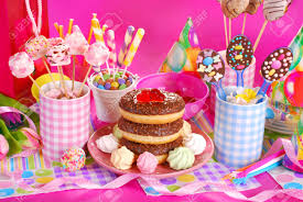 colorful birthday party table with flowers gift and homemade