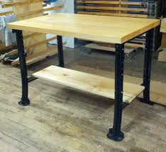 custom butcher block desk with black metal legs and storage for