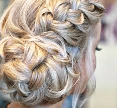 lovely hair put up in a side with a plait hairstyles and makeup
