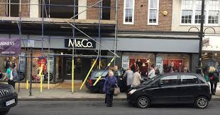 a car crashed into town centre shopfronts in east grinstead kent