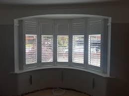5 panel curved bay window installation absolute plantation shutters