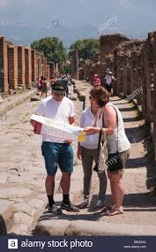 Map Of Pompeii Italy by Tourists Share A Map In The Ancient City Of Pompeii Italy Stock