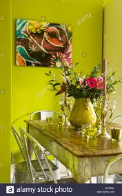 Kitchen Green Kitchen Colors Stock Kitchen Table With Bold Lime Green Painted Walls Stock Photo