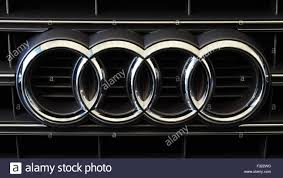 the audi logo of four interlocking rings on the grille of an audi