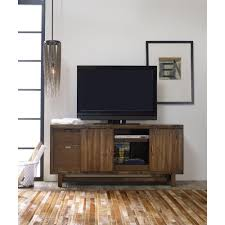 glide entertainment center with farmhouse style doors by hooker