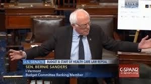 bernie sanders attacks trump on senate floor using giant printed
