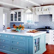 soft blue kitchen island with white countertop and classic white