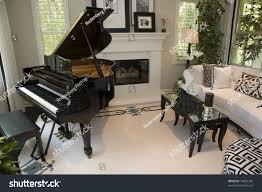 contemporary living room fireplace grand piano stock photo