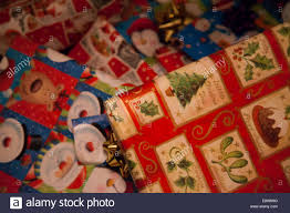 christmas gifts wrapped and under the tree stock photo royalty