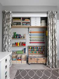 gift wrapping room with gray and white closet transitional and