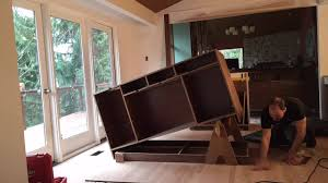 how do you attach island cabinets to the floor installing an island