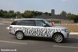 new land rover defender spy shots new range rover long wheelbase spied near the nürburgring