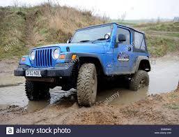 jeep rubicon offroad modified jeep wrangler driving off road in deep wet mud and water