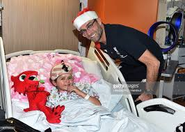 deliver presents liverpool players deliver presents to alder hey hospital photos