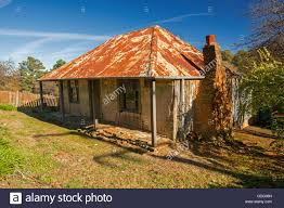 historic building old miner u0027s cottage with rusty roof red brick