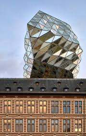 zaha hadid architects sits glass lump on top of antwerp port building