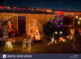 Outdoor Christmas Lights Decorations by Home Decorated With Christmas Lights And Decorations On Street In