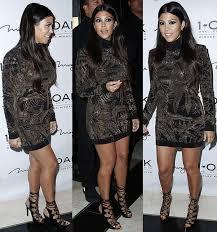 kourtney kardashian in black and gold dress and tom ford heels