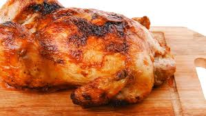 fresh whole turkey poultry fresh grilled whole chicken on wooden cutting board