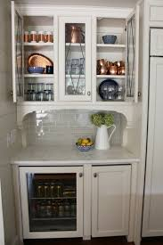how do you arrange dishes in kitchen cabinets how to style beautiful and functional glass kitchen cabinets