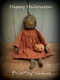 primitive black pumpkin doll and jack o lantern halloween extreme