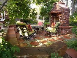 classic backyard patio ideas with brick fireplace facing cozy sofa