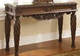 cross island sofa table console sofa table ashley t719 4 cross island brown oak stained