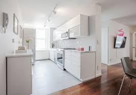 high end ikea kitchen w ikea white glossy sektion cabinets and highend appliances
