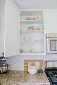 should i put shelf liner in new cabinets how to line your kitchen cabinets easily all things mamma