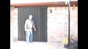 sliding glass door protection accordion hurricane shutters deployed by homeowner mp4 youtube