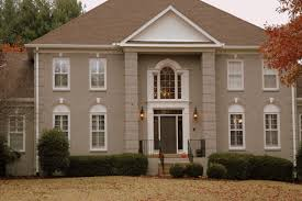 exterior painted brick houses with window treatments and front