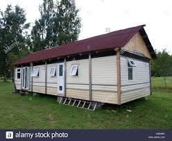 small country house made from big camping trailer stock photo