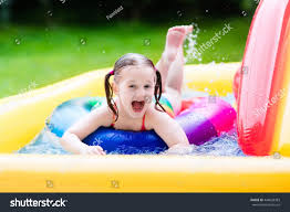 children playing inflatable baby pool kids stock photo 444698383