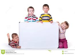 Big White Boards Four Children Holding A White Board Royalty Free Stock Image