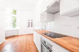 modern white kitchen cabinets wood floor white kitchen modern kitchen wooden floor stock photo image now
