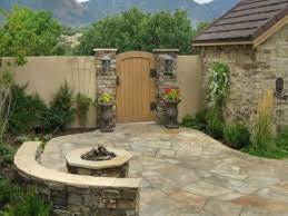 floor rock flagstone patio with round stone fire pit and wood