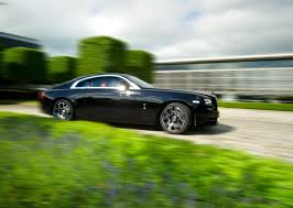 rolls royce sports car rolls royce celebrates goodwood with dark and edgy presence just