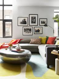 living room gray sofa black coffee table white table lamps gray