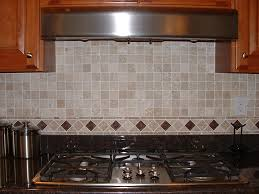 interior white subway tile backsplash and marble countertops