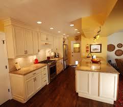 Glazed White Kitchen Cabinets by Kraftmaid Bisque Glaze Cabinets With Cambria Brownhill Quartz
