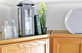 top of kitchen cabinet greenery 12 ways to decorate above kitchen cabinets tag tibby design